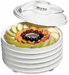 Food dehydrator filled with dried fruit